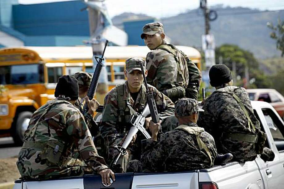Soldiers guard ballots on their way to a polling station in Tegucigalpa, Saturday, Nov. 28, 2009.  With President Manuel Zelaya, who was ousted in a military coup last June, still holed up in the Brazilian embassy, voters will choose a new president Nov. 29 from the political establishment that has dominated Honduras for decades. (AP Photo/Rodrigo Abd) Photo: Rodrigo Abd, AP
