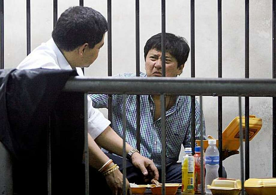 Mayor Andal Ampatuan Jr., right, of Unsay township, Maguindanao province in southern Philippines, talks to his lawyer inside the National Bureau of Investigation (NBI) detention center upon arrival in Manila from General Santos city following his surrender to authorities Thursday Nov. 26, 2009. Ampatuan Jr. was implicated in the massacre Monday of 57 people, including 18 journalists, at Maguindanao province in southern Philippines in what the president's office called the worst political violence in recent history. (AP Photo/Mike Alquinto) Photo: Mike Alquinto, AP
