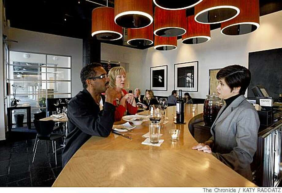 Eloisa Castillo, right, owner of Mono's, chats with early customers at Mono, a restaurant in Oakland, Calif.  on Wednesday May 28, 2008. Photo: KATY RADDATZ, The Chronicle