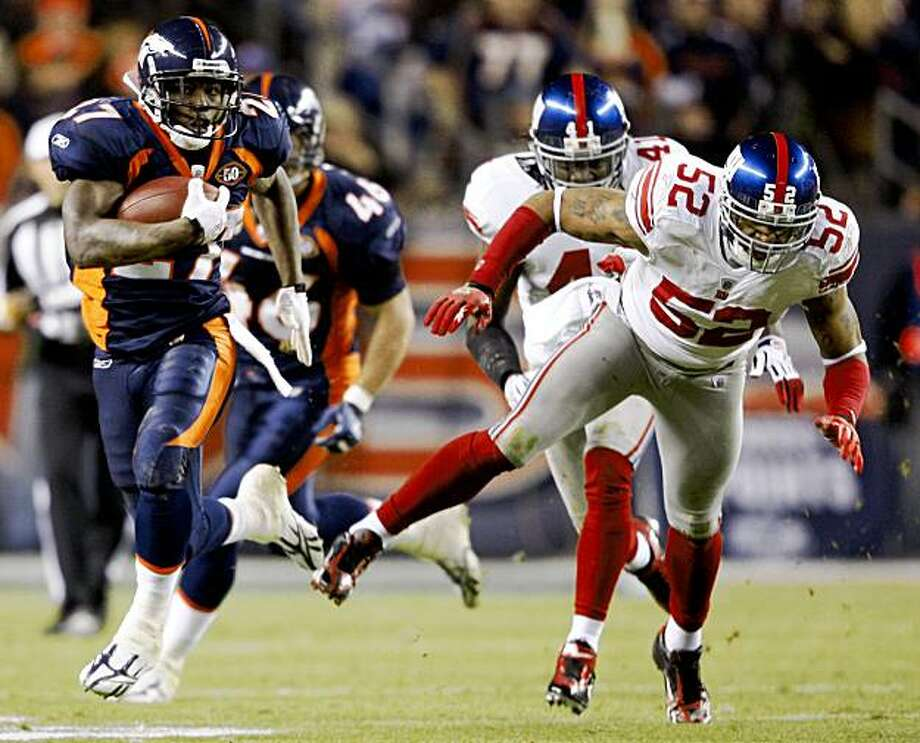 Denver Broncos running back Knowshon Moreno (27) runs past New York Giants linebacker Michael Boley (52) during the second quarter of an NFL football game in Denver, Thursday, Nov. 26, 2009. (AP Photo/Jack Dempsey) Photo: Jack Dempsey, AP