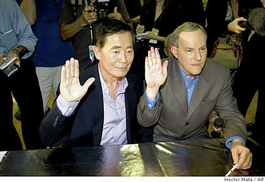 George Takei, left, and his partner Brad Altman raise their hands as they get their marriage certificate permit in West Hollywood, Calif. on Tuesday, June 17, 2008. The May 15 California Supreme Court ruling that overturned the state's bans on same-sex marriage became final at 5:01 p.m. Monday. (AP Photo/Hector Mata) Photo: Hector Mata, AP