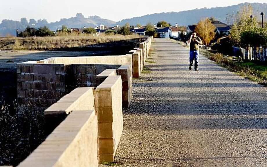 A levee on the east part of Hamilton Field is a popular walking area. Hamilton Field in Novato is a bright, newish housing and work environment at the old Hamilton Air Force Base. Photo: Brant Ward, The Chronicle