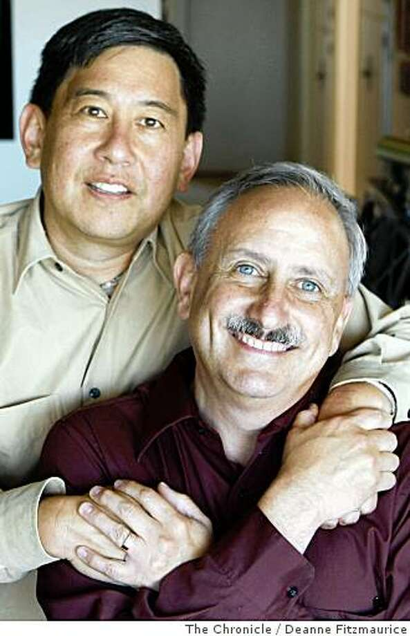 Derrick Kikuchi , left, and Craig Wiesner  were the first same gender couple to get married in 1990 at First Presbyterian Church in Palo Alto. They are in their home in Daly City, Calif. on June 12, 2008.  Photo by Deanne Fitzmaurice / The Chronicle Photo: Deanne Fitzmaurice, The Chronicle