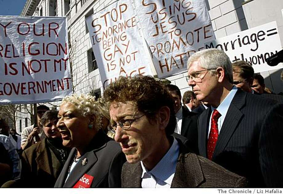 Petitioners Diane Sabin (middle) and Jewelle Gomez (middle, left)  voice their opinions in front of the state building on Tuesday after oral hearings in the same-sex marriage case., March 4, 2008, in San Francisco, Calif. Photo by Liz Hafalia/San Francisco Chronicle Photo: Liz Hafalia, The Chronicle