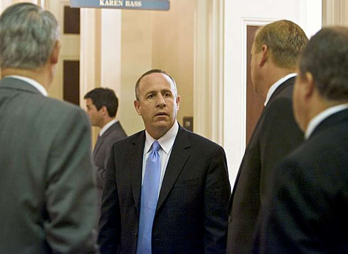 President pro tem of the Senate Darrell Steinberg (D-Sacramento) center, speaks with state Senator Jeff Denham ( R-Merced), second from right), in the hall outside his office as the Assembly as the state Senate and Assembly vote on hundreds of bills, trying to beat a midnight end of session deadline, September 11, 2009 in Sacramento, California.
