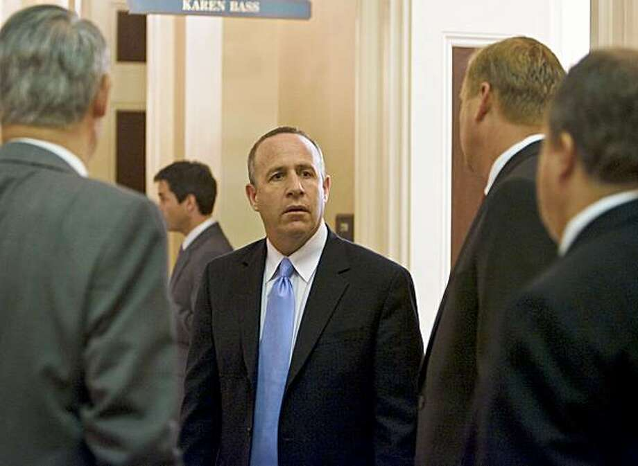 President pro tem of the Senate Darrell Steinberg (D-Sacramento) center, speaks with state Senator Jeff Denham ( R-Merced), second from right), in the hall outside his office as the Assembly as the state Senate and Assembly vote on hundreds of bills, trying to beat a midnight end of session deadline, September 11, 2009 in Sacramento, California. Photo: Robert Durell, Special To The Chronicle