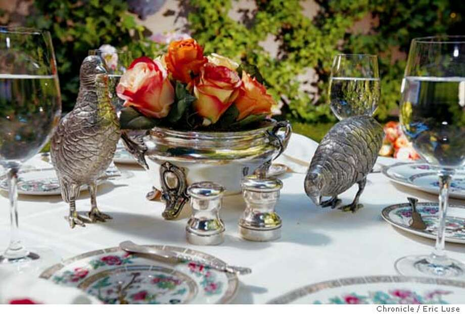 Beautify the table with soft-colored flowers, coordinated dishes and silverware, and those overlooked objets d'art hiding in your closets and cabinets. Chronicle photo by Eric Luse