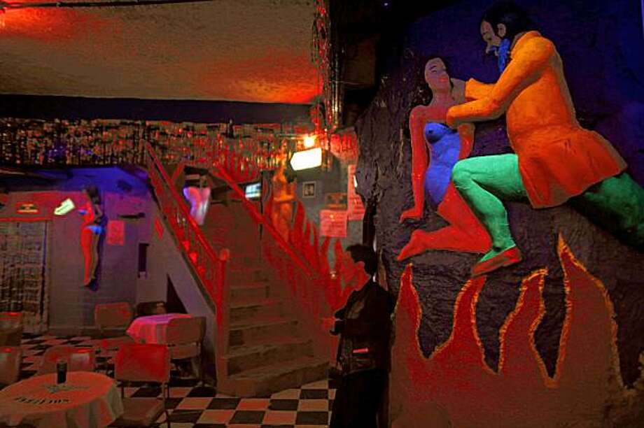 **ADVANCE FOR MONDAY, NOV. 23**  This Aug. 22, 2009 photo shows a waiter leaning against the wall as he waits for customers at the Barba Azul night club in Mexico City. Once the bohemian underbelly of Mexico City's storied nightlife, legendary dance-for-peso nightclubs like the Barba Azul are dying. (AP Photo/Dario Lopez-Mills) Photo: Dario Lopez-Mills, AP