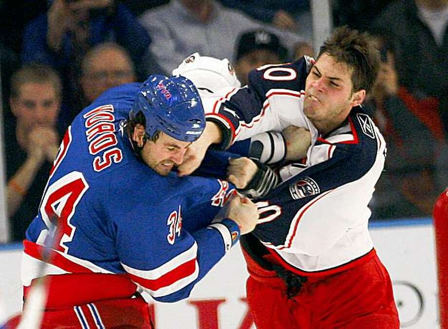 New York Rangers Aaron Voros (34) fights with the Columbus Blue Jackets Jared Boll (40) during the second period of an NHL hockey game at Madison Square Garden in New York, Monday, Nov. 23, 2009. The Rangers won the game 7-4.  (AP Photo/Paul J. Bereswill) Photo: Paul J. Bereswill, AP