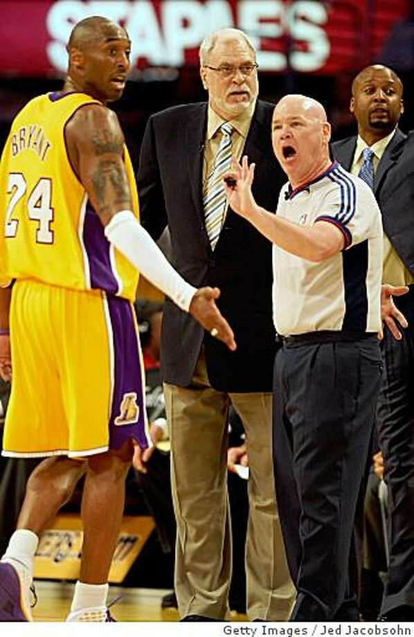 LOS ANGELES, CA - JUNE 10:  Head coach Phil Jackson and Kobe Bryant #24 of the Los Angeles Lakers argue a call with referee Joe Crawford while taking on the Boston Celtics in Game Three of the 2008 NBA Finals on June 10, 2008 at Staples Center in Los Angeles, California. NOTE TO USER: User expressly acknowledges and agrees that, by downloading and/or using this Photograph, user is consenting to the terms and conditions of the Getty Images License Agreement.  (Photo by Jed Jacobsohn/Getty Images) Photo: Getty Images