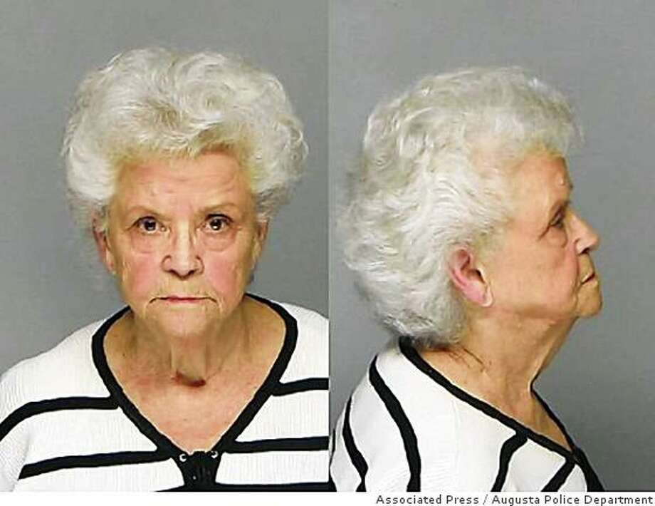 In this photo provided by the Augusta, Ga., Police Dept. Betty Johnson Neumar is shown at her booking in Augusta, Ga., Tuesday, June 10, 2008.  It took years, but authorities have charged the 76-year-old with hiring a hit man, and investigators think  she may have also killed her four other husbands in four other states. (AP Photo/  Augusta Police Dept.) Photo: Augusta Police Department, Associated Press