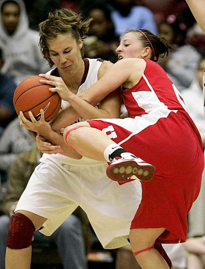 Stanford's Kayla Pedersen, left, battles for a loose ball against Utah's Kalee Whipple during the second half of an NCAA college basketball game in Stanford, Calif., Friday, Nov. 27, 2009. Stanford won 60-41. (AP Photo/Marcio Jose Sanchez) Photo: Marcio Jose Sanchez, AP