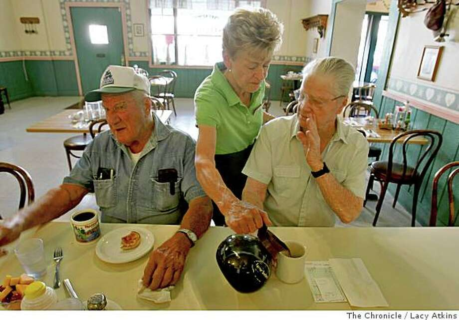 Fran Paul, middle pours some coffee and George Vonasek, left, and John Young talk about their views on samesex marriage, while having breakfast at the Kountry Kitchen, Tuesday June 10, 2008, in Orland, Calif. Lacy Atkins /The San Francisco Chronicle Photo: Lacy Atkins, The Chronicle