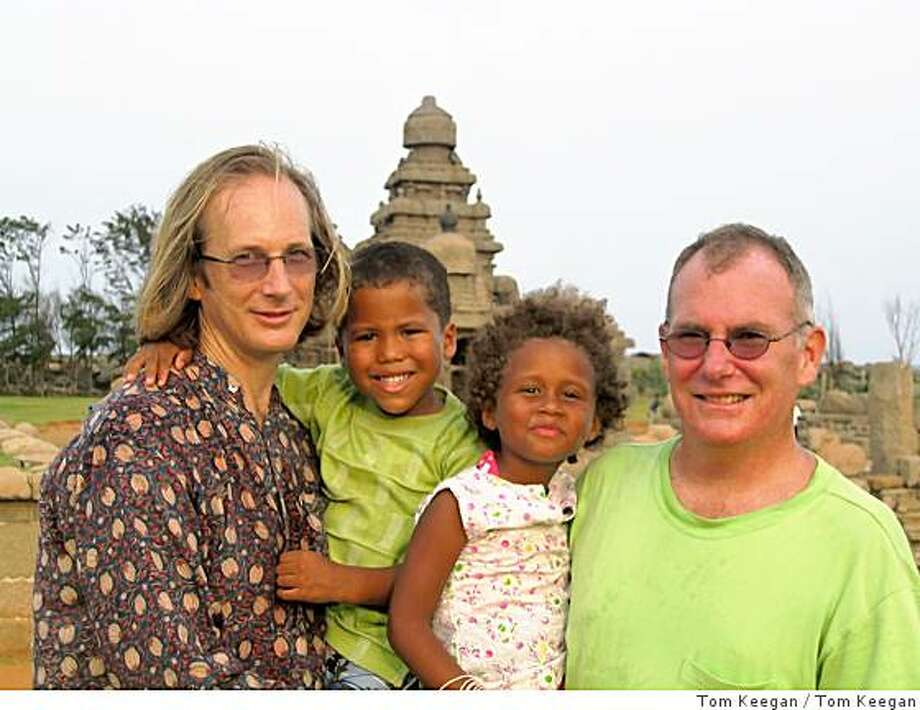"Photo from ""Out in India: A Family's Journey""The Carley Gere family in front of ancient temples at Mahabalipurum, India. Pictured, left to right: David Gere, Christopher Carley Gere, Isadora Carley Gere, Peter Carley.Photographer: Tom Keegan Photo: Tom Keegan"