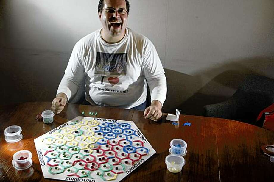 Game designer Evan Koch sits for a portrait with his newest creation called Zurround on Tuesday Sept. 1, 2009 in San Francisco, Calif. Photo: Mike Kepka, The Chronicle