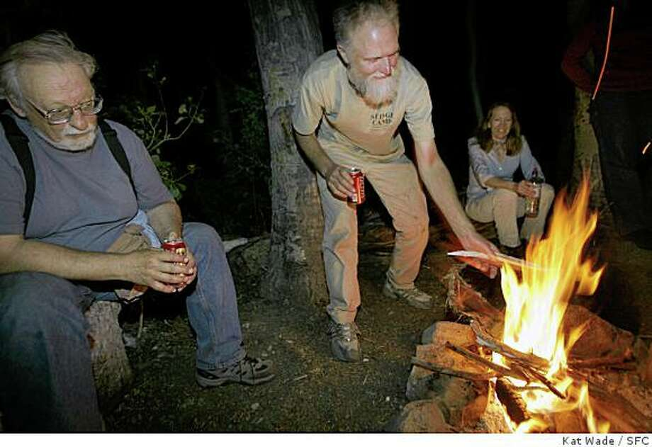 "ATTEN: ADDITIONAL CAPTION INFORMATION: (L to R) Dave DeSante and Brett Engstrom two of the 12 original members of the Mono Basin Research Group around the camp fire at Mono Lake in Lee Vining Saturday July 16, 2006. (Far right) Law professor Jamie Grodsky. 30-years-after a group of 12 scientists worked to save Mono Lake and it's delicate ecosystem, the original scientists, their families and some of the ""honorary"" members of the group gathered from around the country for a weekend reunion. Kat Wade/The Chronicle Photo: Kat Wade, SFC"
