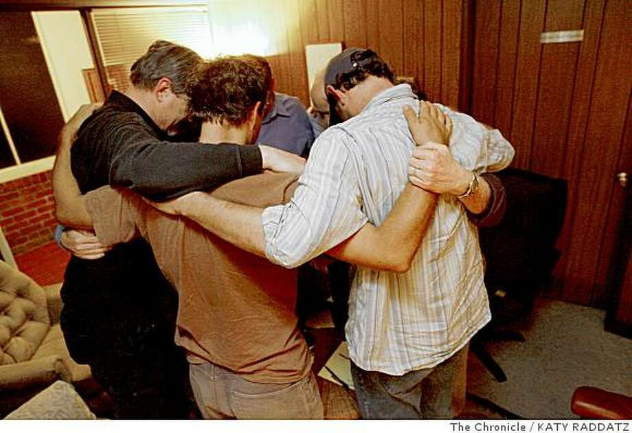 Members of Fathers' Forum,  a group of men who meet every other week to discuss new dad issues, led by family therapist Bruce Linton,  gather for their end-of-meeting group hug, in Berkeley,  Calif.  on Wednesday June 4, 2008.Photo by Katy Raddatz / The Chronicle Photo: KATY RADDATZ, The Chronicle