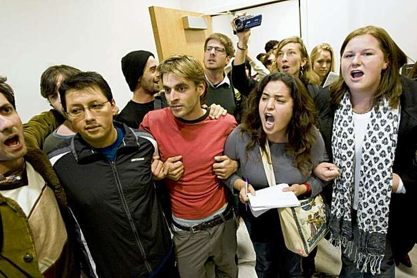 Protesters enter the University of California offices where President Mark Yudof has his office demanding to speak to Yudof about the fee hikes in Oakland, Calif., on Monday, Nov. 23, 2009. The protesters did not succeed in speaking to Yudof, but had their questions answered by two representatives.