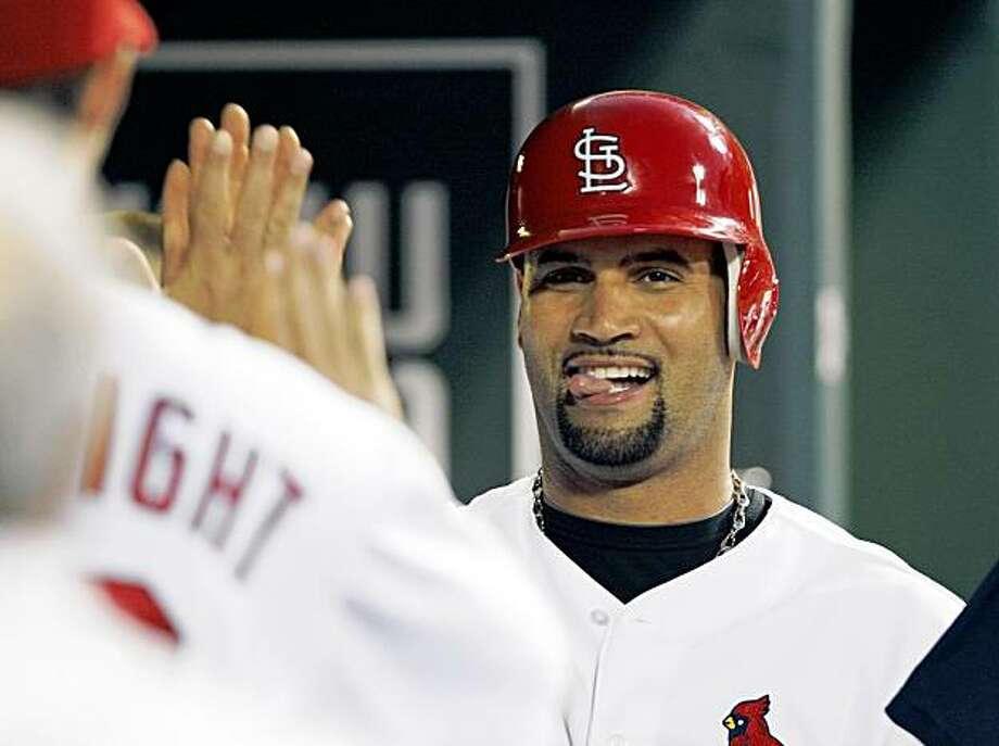 FILE - In this Aug. 29, 2009, file photo, St. Louis Cardinals' Albert Pujols smiling after scoring from second on an error by Washington Nationals shortstop Cristian Guzman during the fifth inning of a baseball game, in St. Louis. Pujols was unanimously voted National League MVP on Tuesday, Nov. 24, 2009, becoming the baseball first player to repeat since Barry Bonds won four in a row from 2001-04. (AP Photo/Tom Gannam, File) Photo: Tom Gannam, AP