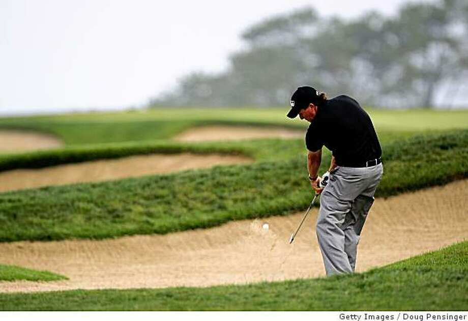 SAN DIEGO - JUNE 12:  Phil Mickelson hits his second shot on the fourth hole during the first round of the 108th U.S. Open at the Torrey Pines Golf Course (South Course) on June 12, 2008 in San Diego, California.  (Photo by Doug Pensinger/Getty Images) Photo: Getty Images