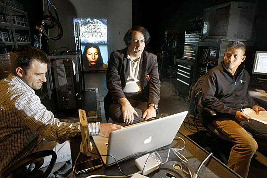 Artists Ben Wood (left) and David Mark (middle) do a check on projectors through their computer at Video Equipment Rentals in South San Francisco, Calif., on Thursday, November 19, 2009.  Alfredo Aquino (right), who is renting them the projector equipment is advising. Photo: Liz Hafalia, The Chronicle
