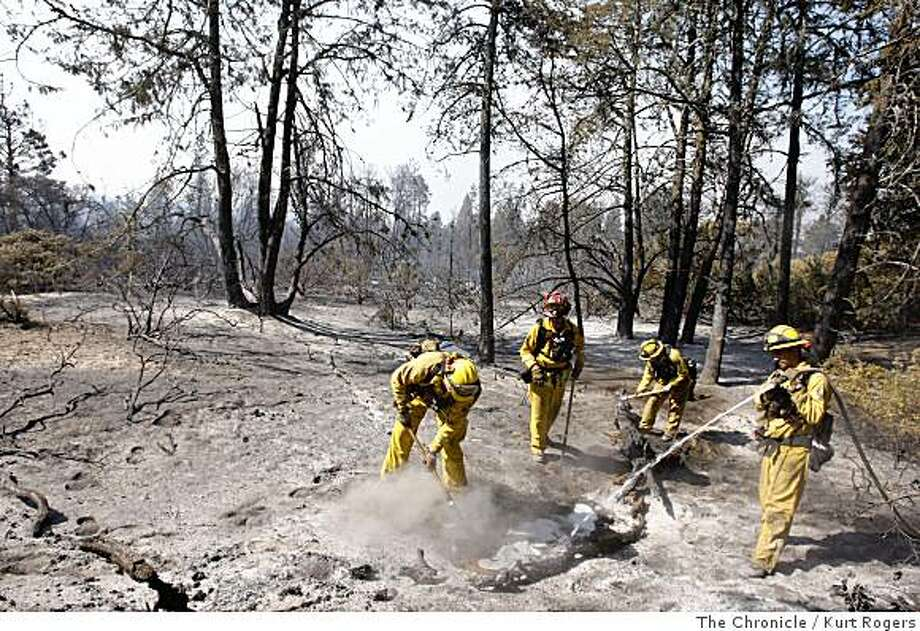 A fire crew from Humboldt county's Weott Station helps fight the Martin Fire on Thursday, June 12, 2008 in Bonny Doon, Calif.  Photo by Kurt Rogers / The Chronicle. Photo: Kurt Rogers, The Chronicle