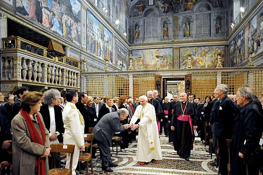 VATICAN CITY, VATICAN - NOVEMBER 21:   Pope Benedict XI arrives at the Sistine Chapel for a meeting with the artists on November 21, 2009 in Vatican City, Vatican. Around 500 artists of various genres were invited by Pope Benedict XVI to the Sistine Chapel to discuss renewing the alliance of art and the Church while encouraging the artists to infuse spirituality in their work. Around 250 artists accept the invitation to the gathering.  (Photo by L'Osservatore Romano/The Vatican-Pool/Getty Images) Photo: Pool, Getty Images