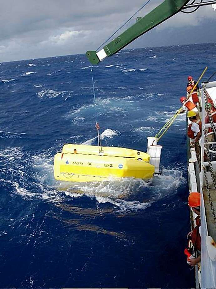 This undated photo released by Census of Marine Life and the Woods Hole Oceanographic Institution shows engineers from the Woods Hole Oceanographic Institution recovering the hybrid underwater robot Nereus aboard the 135 foot RV Cape Hatteras in deteriorating weather conditions above the Mid-Cayman Spreading Center in the Caribbean Sea. Thousands of marine species eke out an existence in the ocean's pitch-black depths by feeding on the snowlike decaying matter that cascades down, and even sunken whale bones, according to a report released Sunday. Photo: Chris German, AP