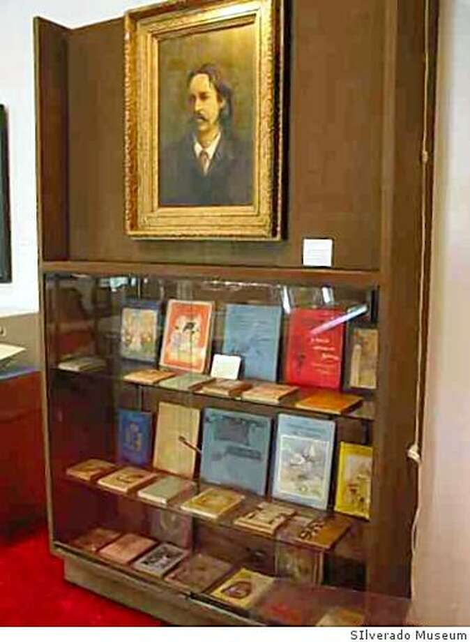 Rare first editions of Stevenson works undera portrait of Stevenson by J. Rutherford Patrick at the Silverado Museum in St. Helena. The museum is devoted to Robert Louis Stevenson memorabilia. Photo: SIlverado Museum
