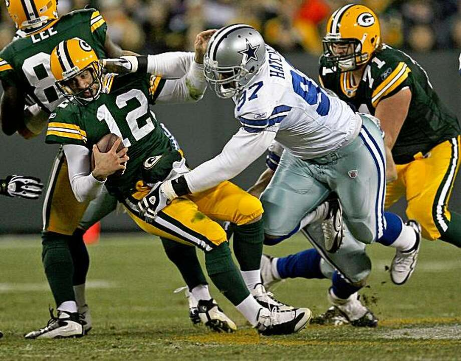GREEN BAY, WI - NOVEMBER 15: Aaron Rodgers #12 of the Green Bay Packers is sacked by Jason Hatcher #97 of the Dallas Cowboys at Lambeau Field on November 15, 2009 in Green Bay, Wisconsin. The Packers defeated the Cowboys 17-7. (Photo by Jonathan Daniel/Getty Images) Photo: Jonathan Daniel, Getty Images
