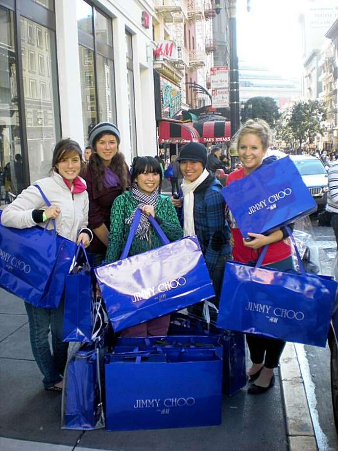 "A group of USF students, a.k.a.  the ""Fab five"": Alia Al-Sharif, 21; Alex Platt, 21; Holly Luong, 23; Nghi Lu, 23; and Jo Wiencek, 21. They spent $4,500 altogether on H&M's Jimmy Choo collection, which went on sale Nov. 14 at the Powell Street store. Photo: Meredith White, San Francisco Chronicle"