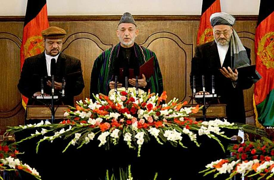 KABUL, AFGHANISTAN - NOVEMBER 19:  President Hamid Karzai recites taking the oath of office along side First Vice President Mohammad Qasim Fahim (L)  and Second Vice president Kareem Khalili (R) during the Inauguration ceremony at the presidential palace on November 19, 2009  in Kabul, Afghanistan. Karzai begins his second term in office amid allegations of corruption and wide spread calls for government  reform.  (Photo by Paula Bronstein /Getty Images) Photo: Paula Bronstein, Getty Images