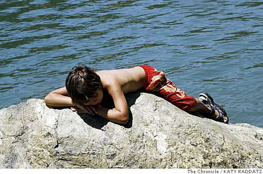 Christian Seader, age 8, from Notvato, basks on a rock at Lake Sonoma in Healdsburg, Calif.  on Sunday June 8, 2008.Photo by Katy Raddatz / The Chronicle Photo: KATY RADDATZ, The Chronicle