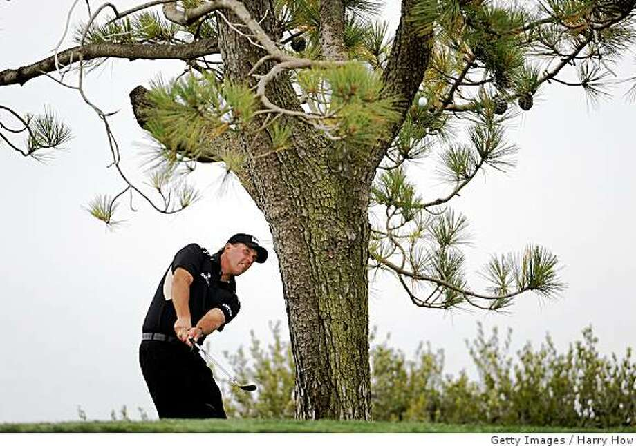 SAN DIEGO - JUNE 14:  Phil Mickelson hits a shot on the fourth hole during the third round of the 108th U.S. Open at the Torrey Pines Golf Course (South Course) on June 14, 2008 in San Diego, California.  (Photo by Harry How/Getty Images) Photo: Getty Images