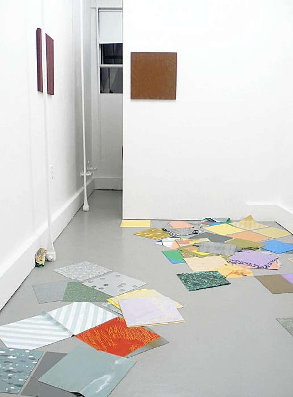 2009 installation of untitled poured latex floor pieces and suede