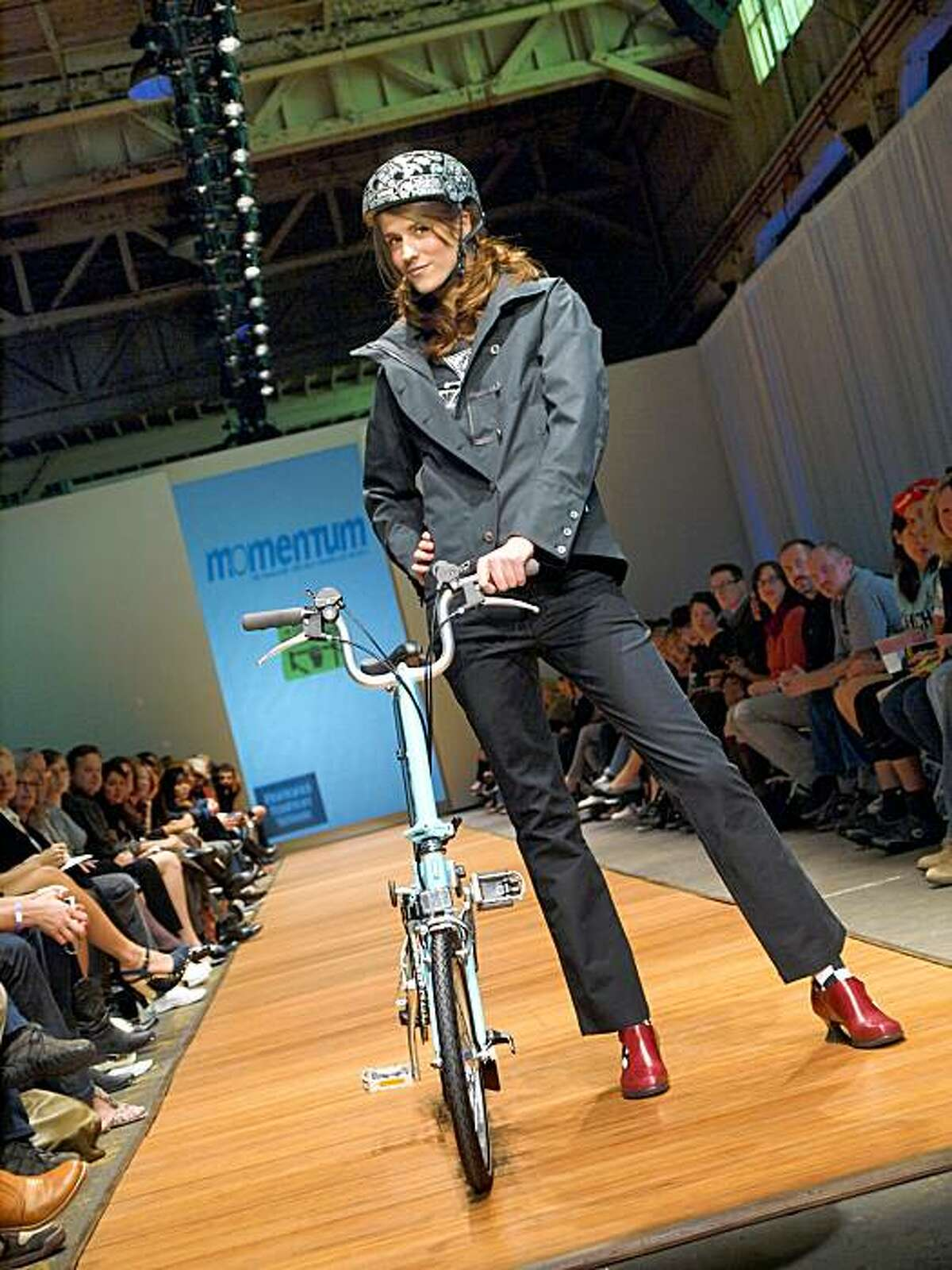 """Sasha Mionova wears a jacket and pants by Nan, a """"true religion"""" T-shirt from Apres, shoes by Fluevog and leggings from Sock Dreams. Her helmet is a Nutcase """"Blackdana""""; her bike a Brompton."""