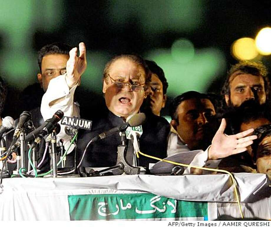 "Former Pakistani premier Nawaz Sharif gestures as he addresses the ""long march"" gathering in Islamabad early June 14, 2008. Tens of thousands of Pakistani lawyers and activists streamed into Islamabad after a cross-country ""long march"" to demand the reinstatement of judges sacked by President Pervez Musharraf. Protesters waved colourful flags from the tops of buses and chanted slogans against the US-backed Musharraf as an ever-growing caravan comprising hundreds of vehicles completed a 24-hour journey from the eastern city of Lahore. AFP PHOTO/Aamir QURESHI (Photo credit should read AAMIR QURESHI/AFP/Getty Images) Photo: AAMIR QURESHI, AFP/Getty Images"