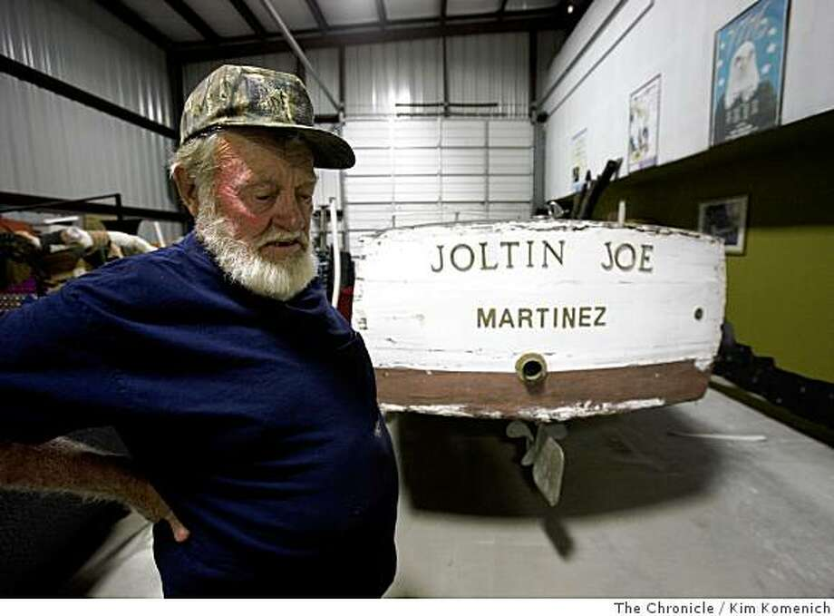 "Alan Hagerthy stands near the The ""Joltin' Joe"", a Chris Craft boat once owned by baseball legend Joe DiMaggio and his family on Tuesday, June10, 2008 in a Martinez, Calif., warehouse. The boat has fallen into disrepair. Hagerthy says he owns the engine from the DiMaggio boat.Photo by Kim Komenich / The Chronicle. Photo: Kim Komenich, The Chronicle"