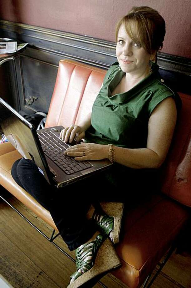 Dawn Miller, owner of a web site Alice & Isa, that carries only locally made women's and men's apparel, accessories and jewelry. In the photograph with her sons (Keegan (8), Finn (6), and Boone (2) at Velo Rouge Cafe, where she often takes her laptop to work on the website, and where she also hosts a monthly fashion film series. Friday, November 13, 2009. San Francisco Calif. Photo: Jana Asenbrennerova, The Chronicle