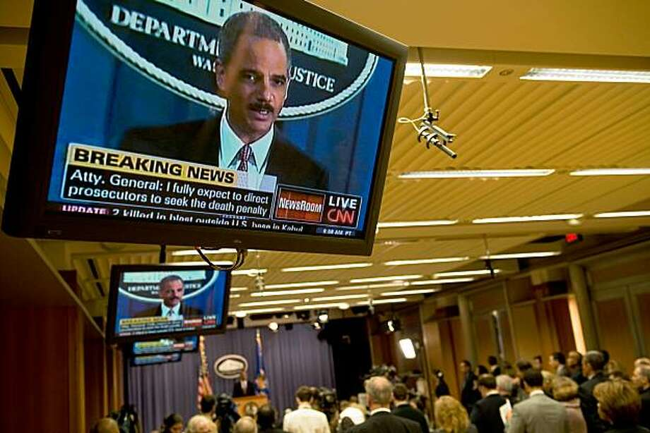 "US Attorney General Eric Holder holds a press conference to announce that five men accused of the September 11 attacks will be tried in a New York civilian court at the Justice Department in Washington on November 13, 2009. Holder, in announcing the decision, said the government would seek the death penalty against Khalid Sheikh Mohammed and the four others, all currently detained at Guantanamo Bay. Holder gave no date for the start of their trial in a court of the Southern District of New York, located in lower Manhattan near ""ground zero"" where the worst of the 9/11 attacks occured.           AFP PHOTO/Nicholas KAMM (Photo credit should read NICHOLAS KAMM/AFP/Getty Images) Photo: Nicholas Kamm, AFP/Getty Images"