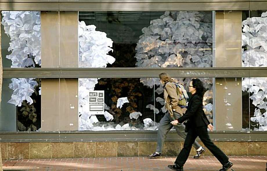 The store at 989 Market Street in downtown San Francisco sits vacant, but is the perfect canvas for artist Paul Hayes to create his paper mobile, Giant Ghosts. November 18, 2009 Photo: Lance Iversen, The Chronicle