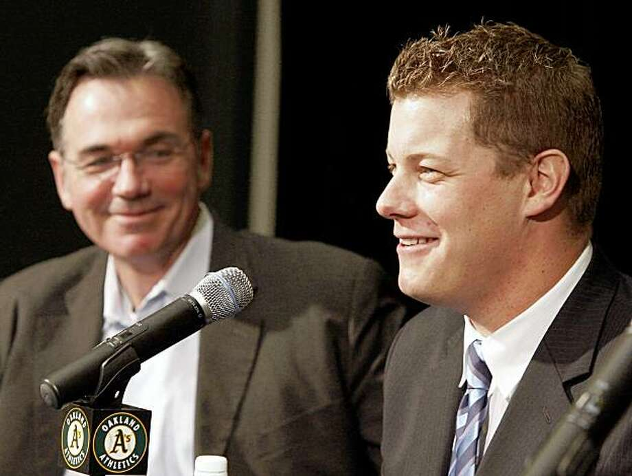 Oakland Athletics' Andrew Bailey, right, smiles beside A's general manager Billy Beane during a baseball news conference on Tuesday, Nov. 17, 2009, in Oakland, Calif. Bailey was selected as the American League Rookie of the Year on Monday, Nov. 16. (AP Photo/Ben Margot) Photo: Ben Margot, AP