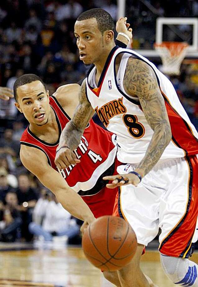 Golden State Warriors' Monta Ellis, right, drives the ball past Portland Trail Blazers' Jerryd Bayless (4) during the second half of an NBA basketball game Friday, Nov. 20, 2009, in Oakland, Calif. (AP Photo/Ben Margot) Photo: Ben Margot, AP