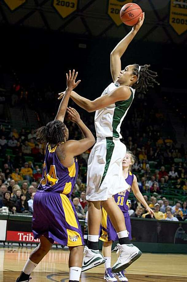 Baylor's Britteny Griner (42) takes a shot over Tennessee Tech defender Simone Rutledge (34) during first half  of an NCAA college basketball game Tuesday Nov. 17, 2009 in Waco, Texas. (AP Photo/Duane A. Laverty) Photo: Duane A. Laverty, AP