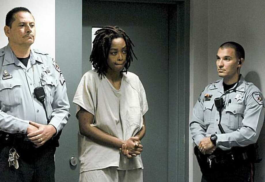 Antoinette Davis, center, listens to her charges on Monday, Nov. 16, 2009 near Sanford, N.C. Davis is the mother of the missing 5-year-old who was found dead off a heavily wooded road in a rural area Monday, ending a weeklong search, police said. Searchers found Shaniya Davis' body southeast of Sanford, in central North Carolina, Fayetteville Police spokeswoman Theresa Chance told The Associated Press. Police did not say how she died. (AP Photo/The Fayetteville Observer, Ashley Cross) ** MAGS OUT NO SALES MANDATORY CREDIT ** Photo: Ashley Cross, AP