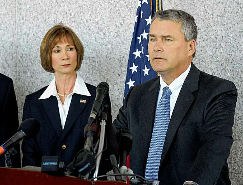 Criminal Chief U.S. District Attorney F. Gentry Shelnutt, right, speaks during a news conference on military fraud as assistant U.S. District Attorney Barbara Nelan, on Monday, Nov. 16, 2009 in Atlanta. A Kuwaiti company has been charged with conspiring to defraud the U.S. in connection with multibillion-dollar contracts to feed American troops in Iraq, Kuwait and Jordan. Federal prosecutors said Monday that Public Warehousing Co. made false statements and submitted false claims to manipulate prices and overcharge for food for troops. (AP Photo/Erik S. Lesser) Photo: Erik S. Lesser, AP