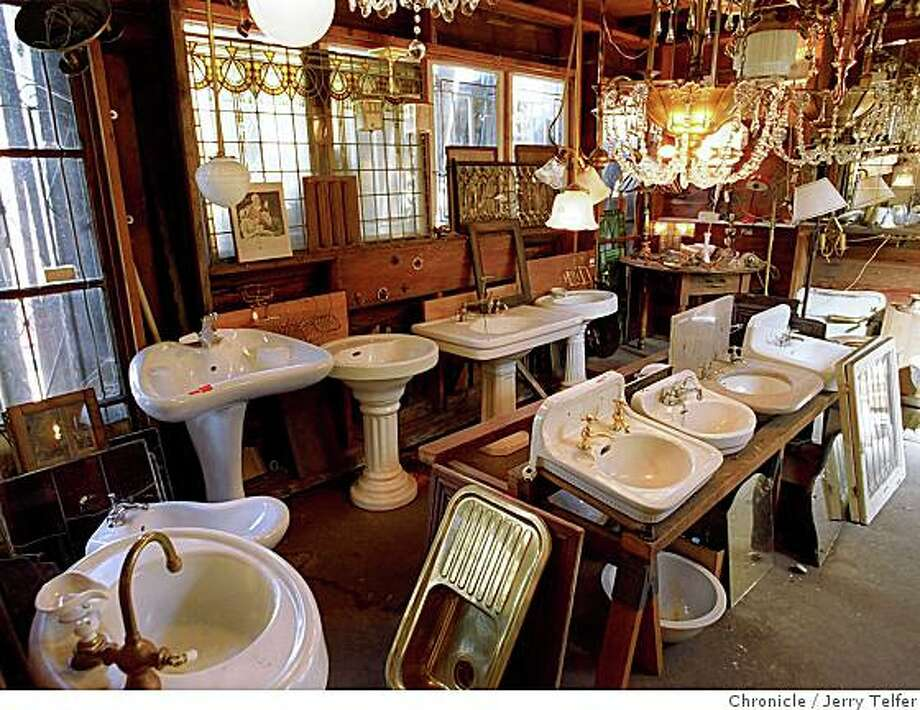Pedestal sinks, stained glass windows and lighting fixtures at Omega Salvage in Berkeley. Photo: Jerry Telfer, Chronicle