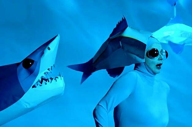 Isabella Rossellini, dressed as an anchovy, runs from a shark in Green Porno, her series of short films and book about the mating habits of marine mammals and insects. Photo: Courtesy, Sundance Channel