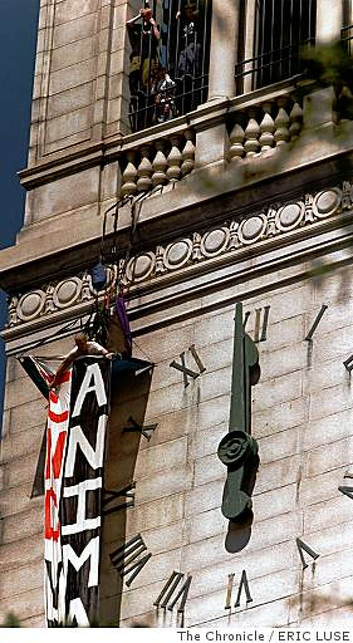 ANIMALS/C/21APRIL98/MN/EL Mike Kennedy,Davis, attempts to unvail a banner on UC Berkeley's Campanile bell tower protesting the use of animals in laboratory testing at UC Berkeley. He is member of Animal Rights Direct Action Coalition.