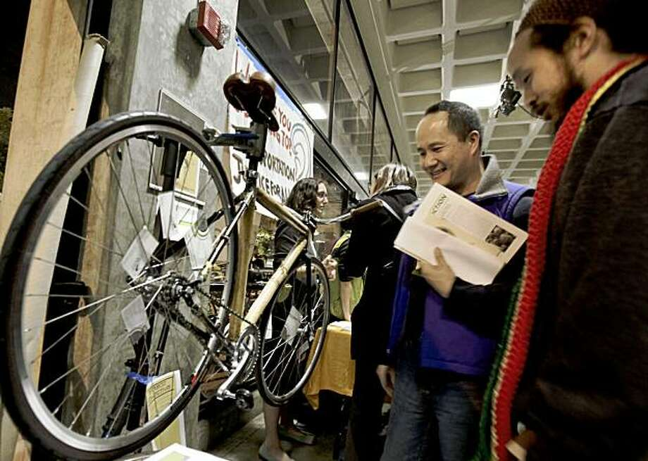 The Bamboo Collective showed off a bike made with local bamboo and called attention to their Richmond SPOKES program which would have Richmond youth build the bikes. The Oakland Climate Action Coalition sponsored a community gathering to support green jobs and a green economy at Laney College Wednesday November 18, 2009. Photo: Brant Ward, The Chronicle